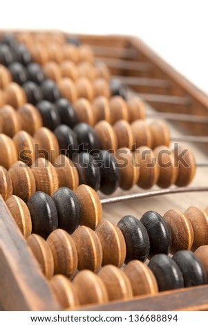 Close up of a wooden abacus beads. Selective focus, shallow depth of field - stock photo