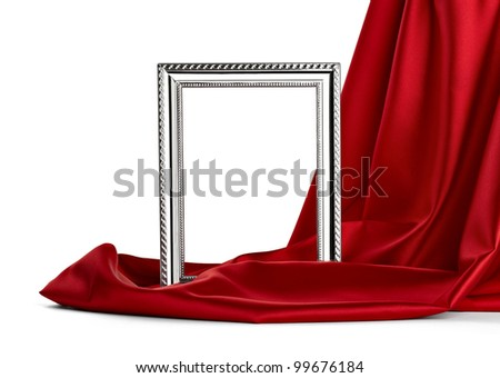 close up of  a wooden frame covered with silk on white background with clipping path - stock photo