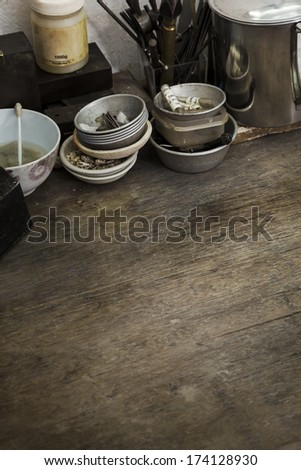 close up of a wooden table in a art and craft workshop. - stock photo