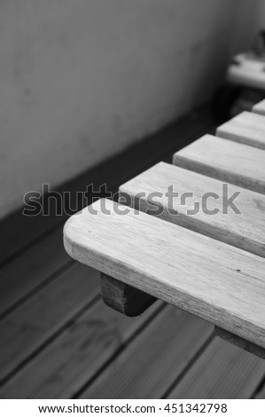 Close up of a wooden table in black and white