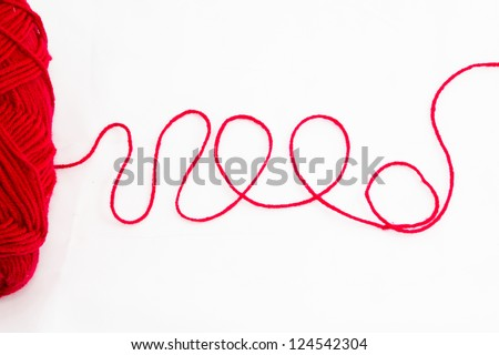 close up of a wool ball and abstract shape on white background - stock photo