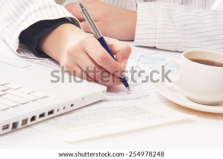 Close-up of a workplace of a businesswoman - stock photo