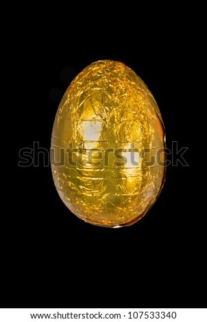 Close-up of a yellow chocolate Easter egg. - stock photo
