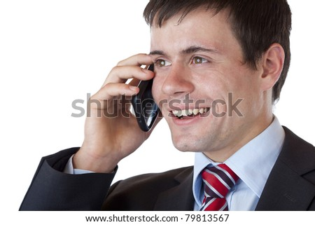 Close-up of a young businessman phoning happily with mobile. Isolated on white background. - stock photo