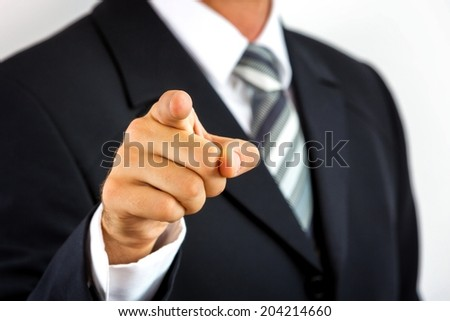 Close up of a young businessman, pointing with his finger. - stock photo