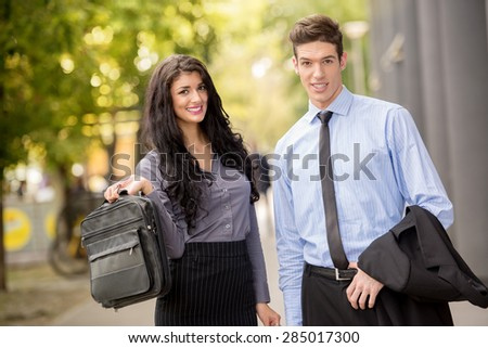 Close-up of a young businessmen and businesswomen walking outside.