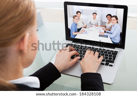 Close-up Of A Young Businesswoman Chatting With His Colleague - stock photo