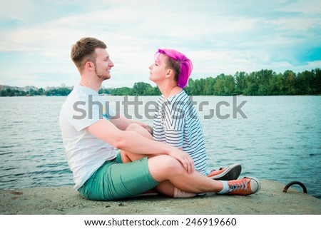 Close up of a young couple visiting at river
