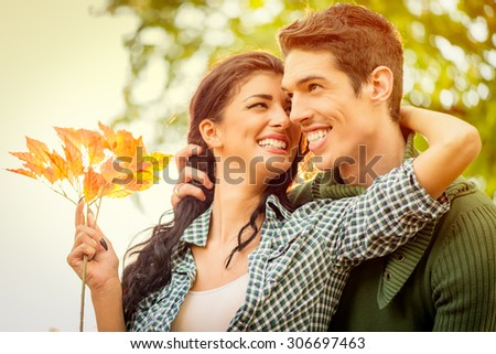 Close-up of a young embraced heterosexual couple with a smile.
