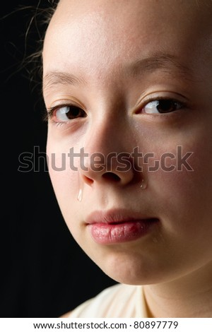 close-up of a young girl crying - stock photo