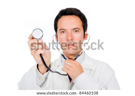 Close-up of a young male doctor listening with stethoscope. ( focus on stethoscope )