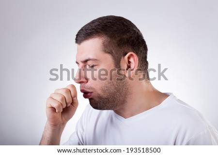 Close-up of a young man having a cough - stock photo