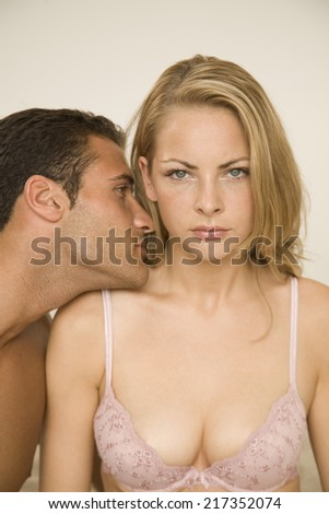 Close-up of a young man romancing with a young woman - stock photo