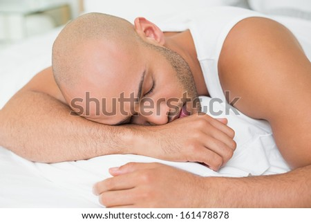 Close up of a young man sleeping in bed at home
