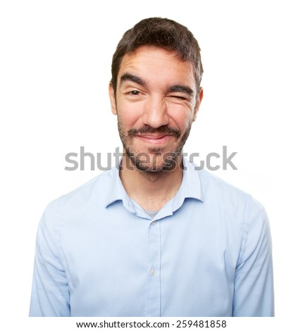 Close up of a young man winking an eye - stock photo