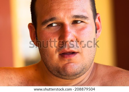 Close up of a young shirtless man. - stock photo