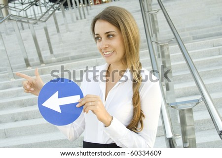 Close-up of a young woman gesturing. In the hands of a traffic sign - stock photo