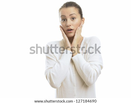 Close-up of a young woman looking surprised against white background