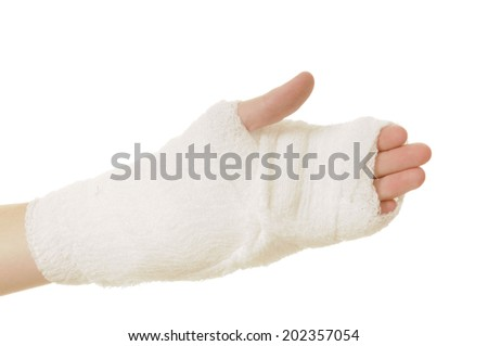 close-up of a young woman's hand  with sports injury to her wrist wrapped in an elastic bandage, isolated on white - stock photo