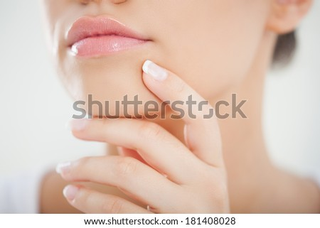 Close-up of a young woman's sensual mouth. - stock photo