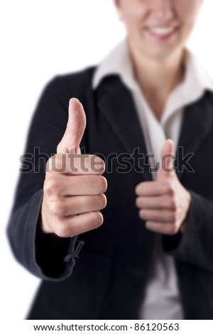 Close-up of a young woman showing thumbs up