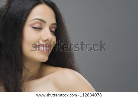 Close-up of a young woman smiling - stock photo