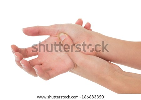Close-up of a young woman touching her palm on white background