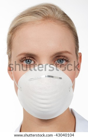 Close-up of a young woman with protecting mask - stock photo
