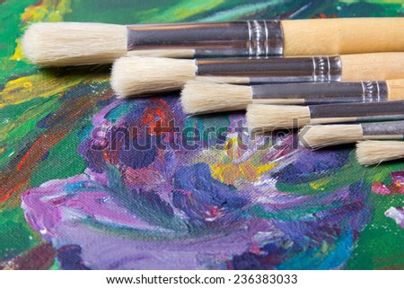 close up of acrylic paint and artist paint brushes set