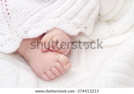 Close up of adorable baby feet on blanket