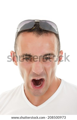 close up of adult man with sunglasses on his head yelling