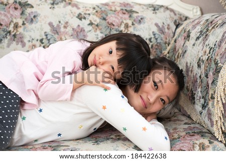 Close Up Of Affectionate Mother And Daughter At Sofa - stock photo