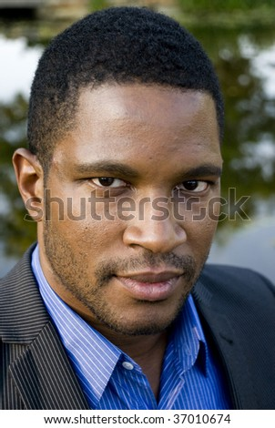 Close up of African American Male in suite - stock photo