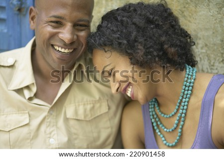 Close up of African couple laughing - stock photo