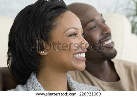 Close up of African couple smiling - stock photo