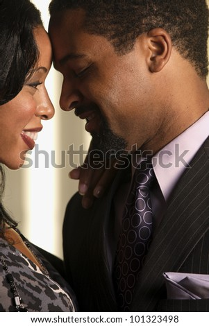 Close up of African couple smiling at each other