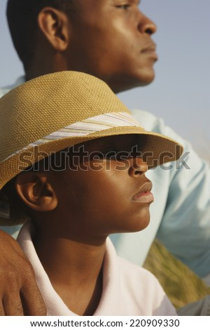 Close up of African father and son at beach - stock photo