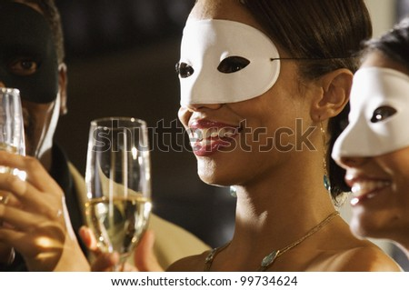 Close up of African woman at masquerade party - stock photo