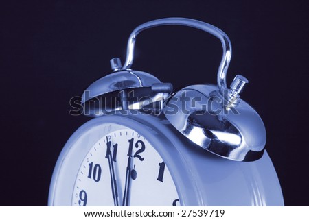Close Up of Alarm Clock on Black Background