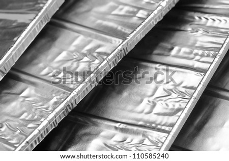 close up of aluminum foil food container tray - stock photo
