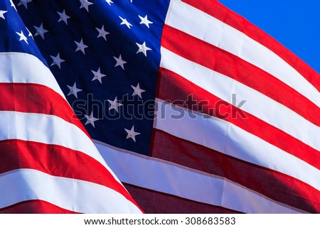 Close up of american flag flying in a wind