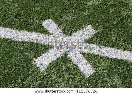 Close-up of American football field with cross sign