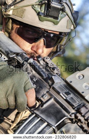 Close up of American Soldier aiming his rifle - stock photo