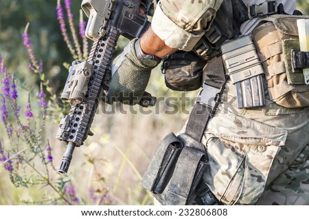 Close up of American Soldier uniform on the bushes - stock photo