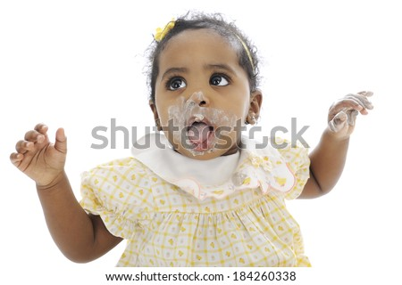 Close-up of an adorable baby girl looking up, with her messy mouth wide opened and hand up wanting help to get cleaned up.  On a white background.