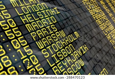 Close-up of an airport departure board to european destinations, with environment reflection.Part of a series.