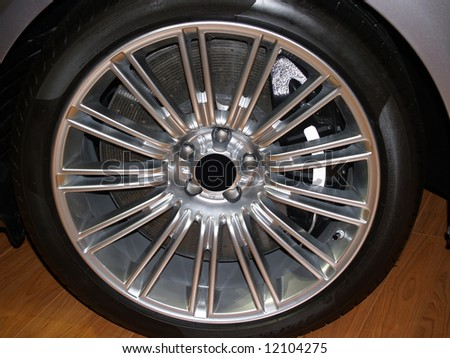 Close up of an alloy wheel of an exotic sports car showing detail of 8 piston brake calipers and carbon ceramic rotor. - stock photo