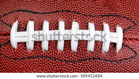 Close up of an American football in filled frame layout.  - stock photo