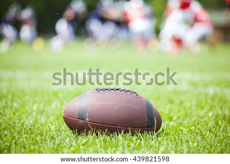 Close up of an american football on the field
