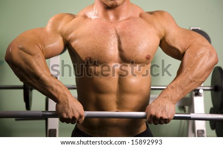 Close-up of an anonymous bodybuilder lifting weights - stock photo